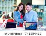 couple shopping for latest... | Shutterstock . vector #741654412
