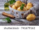 raw potato in basket. a... | Shutterstock . vector #741679162