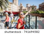 young happy woman tourist in... | Shutterstock . vector #741694582