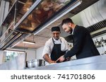 restaurant manager discussing... | Shutterstock . vector #741701806