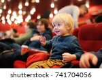 cute toddler boy watching... | Shutterstock . vector #741704056