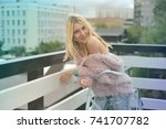 blond girl with red lips in the ...   Shutterstock . vector #741707782
