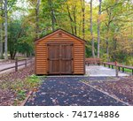 a log cabin in the woods with... | Shutterstock . vector #741714886