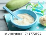 plastic bowl with baby food on...   Shutterstock . vector #741772972