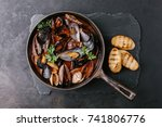 Mussels With Sauce In A Frying...