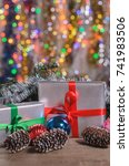 Small photo of Christmas and New Year, gifts with blurred background of garlands with free copy space with free copy space