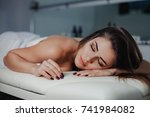 beautiful young woman relaxes... | Shutterstock . vector #741984082