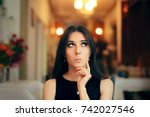 cute girl thinking about her... | Shutterstock . vector #742027546