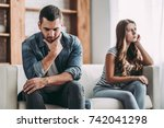 upset couple at home. handsome... | Shutterstock . vector #742041298