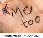 Small photo of # Me too written in the palm