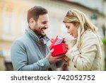 couple in love.man surprising... | Shutterstock . vector #742052752