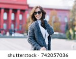 the woman is walking on the... | Shutterstock . vector #742057036