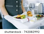 stewardess holding tray with...   Shutterstock . vector #742082992