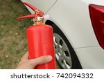 extinguisher in human hand. | Shutterstock . vector #742094332