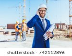 businessman in hardhat and suit ... | Shutterstock . vector #742112896