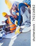 smiling construction workers in ... | Shutterstock . vector #742116862