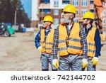 construction workers in... | Shutterstock . vector #742144702