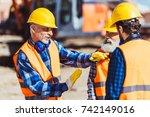 foreman explaining builders... | Shutterstock . vector #742149016