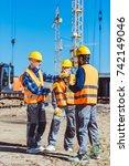 foreman explaining builders... | Shutterstock . vector #742149046