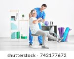 physiotherapist working with... | Shutterstock . vector #742177672