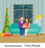 couple at home sitting on sofa. ... | Shutterstock .eps vector #742195636
