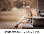 a little girl with an owl in... | Shutterstock . vector #742196446