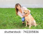 mature woman with her dog in... | Shutterstock . vector #742205836