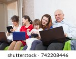 family uses few electronic... | Shutterstock . vector #742208446