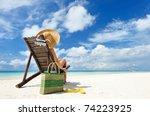 Girl On A Tropical Beach With...