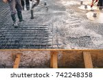 Concrete pouring during commercial concreting floors of buildings in construction - concrete slab - foundation construction - stock photo
