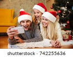 funny beautiful family in santa'... | Shutterstock . vector #742255636