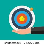 hand of businessman hold target ... | Shutterstock .eps vector #742279186