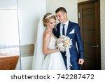 meeting the bride and groom.... | Shutterstock . vector #742287472