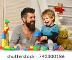 boy and bearded man play... | Shutterstock . vector #742300186