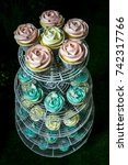 colorful cupcakes on cakestand... | Shutterstock . vector #742317766