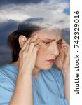 Small photo of Middle aged woman suffering from an acute headache or migraine attack due to weather sensitivity