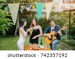 group of friends having party... | Shutterstock . vector #742357192