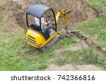 workman using a mini digger to... | Shutterstock . vector #742366816