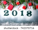 Small photo of Christmas and New Year Background Green colour Wooden Figures 2018 Holiday Symbol Snow Gift boxes Top View Copy space for Text Top View Copy space for Text