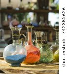 Small photo of Vintage glass vials and bottles alchemy