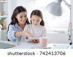 cute positive girl reading a...   Shutterstock . vector #742413706