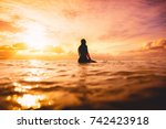 Surf Girl In Ocean At Sunset Or ...