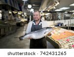 Male Fishmonger Wearing An...