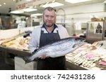 male fishmonger wearing an... | Shutterstock . vector #742431286