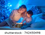 young mother and her son are... | Shutterstock . vector #742450498