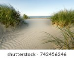 beach with sand dunes and... | Shutterstock . vector #742456246