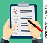 businessman checked list  hand... | Shutterstock .eps vector #742502572