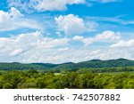 bright blue sky with clouds... | Shutterstock . vector #742507882