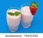 strawberry milkshake on a blue... | Shutterstock . vector #74251552