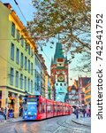 Small photo of Freiburg im Breisgau, Germany - October 14, 2017: Siemens Combino tram in the old town. The Freiburg tram network consists of 5 lines with 73 stops.